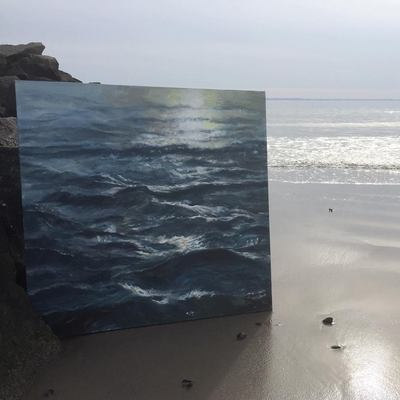blue seascape painting next to the ocean