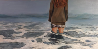 girl wearing a skirt in the ocean looking into the horizon looking lost.